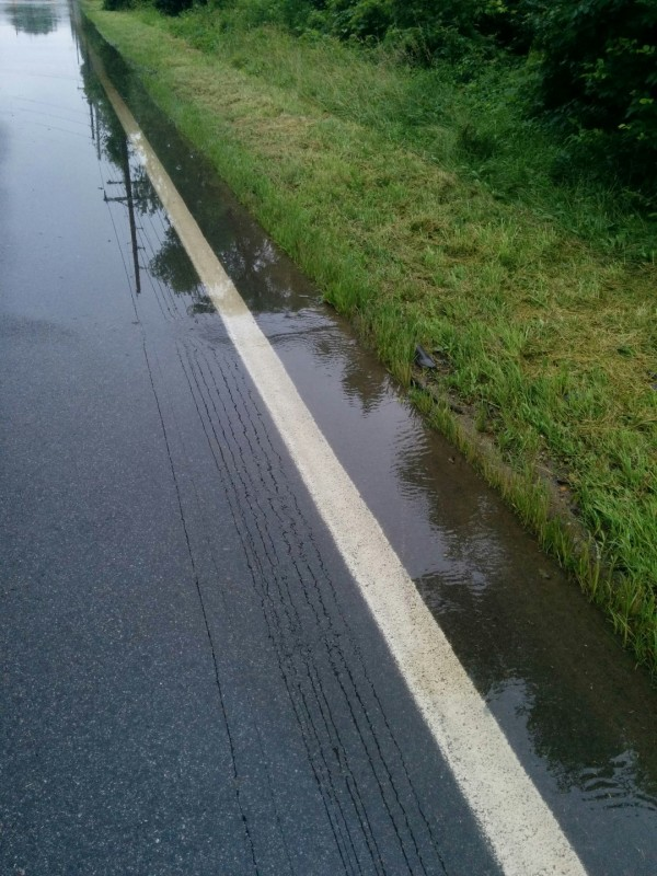 We could watch this spot and see the water coming into the road flooding it deeper!